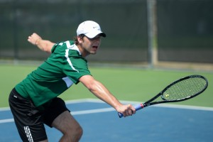 Freshman Jarek Sulak stretches for the shot during his no. 2 doubles match.