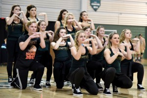 Photo by Elizabeth Feudo. The Baronettes dance team gives a rousing performance to kick off the Midnight Madness events.