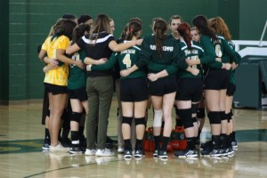 Photo by Joseph Palmer. The Lady Baron Volleyball team discuses their next move during a timeout.