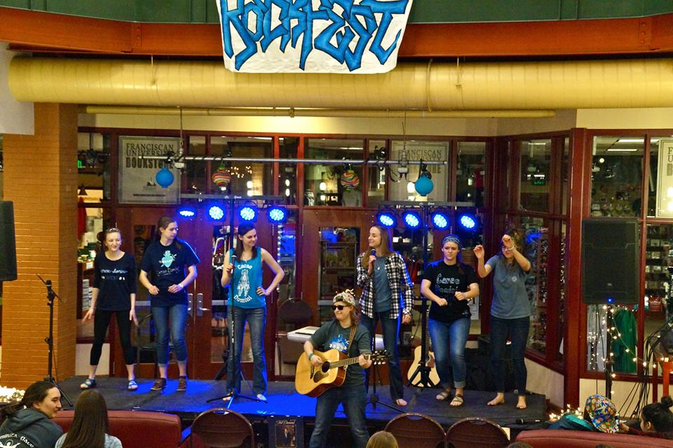 Members of Carae Domini  performing in the lip singing battle at their coffee house. Photo by Liz Bunnell.