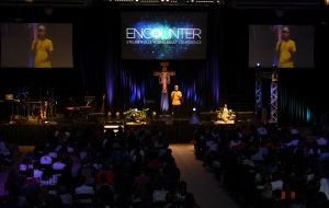 The Encounter Conference draws students, religious, and other participants, filling the Finnegan Fieldhouse. (Photo by Elizabeth Feudo)
