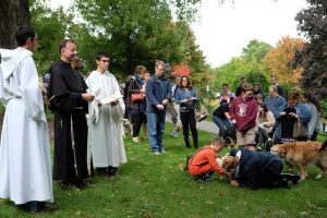 Christ the King Chapel's chaplain, The Rev. Shawn Roberson, prepares to bless the animals. (Photo by Ulises Iniguez)