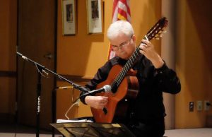 Ronald William Dubois gives a lecture on Sacred Music for Classical Guitar and plays a couple of pieces. (Photo by Ulises Iniguez)