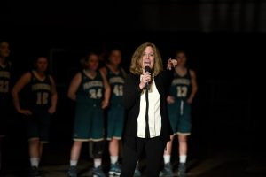 Women's basketball coach Suzy Delaney addresses the crowd during Midnight Madness. Photo by Elizabeth Feudo)