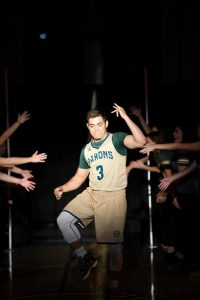 Keoni Sablan, junior, gets his groove on during team introductions at Midnight Madness. (Photo by Elizabeth Feudo)