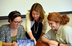 Education professor Dr. Susan Poyo with seniors Cathleen Nelson and Rachel Clark delves into studies via the virtual world. (Photo FUS provided)