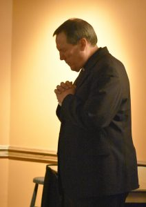 The Rev. Peter Ryan, SJ gets ready for his talk on vocational discernment